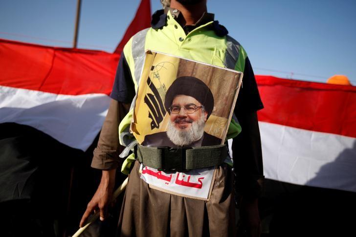 A man sports a poster of Lebanon's Hezbollah leader Sayyed Hassan Nasrallah during a demonstration to commemorate Ashura in Sanaa, Yemen October 12, 2016. REUTERS/Khaled Abdullah/File Photo