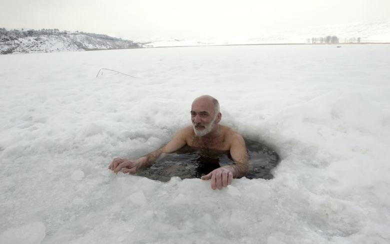 A man bathes in an ice-hole in Lisi Lake, with the air temperature at about minus 6 degrees Celsius (21.2 degrees Fahrenheit), in Tbilisi February 9, 2012. REUTERS/David Mdzinarishvili