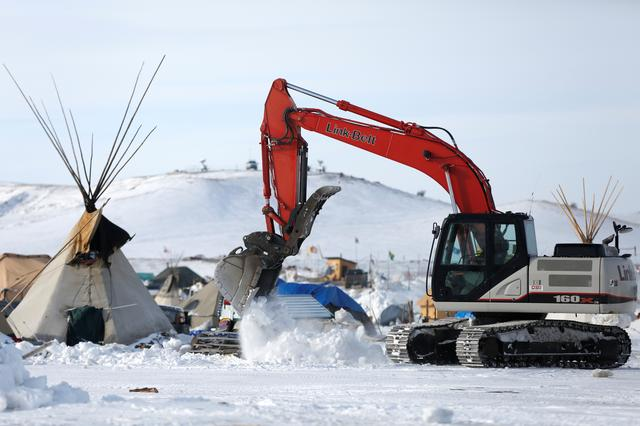 Crews remove waste from the opposition camp. REUTERS/Terray Sylvester