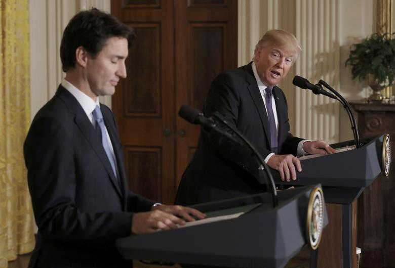 Canadian Prime Minister Justin Trudeau (L) and U.S. President Donald Trump participate in a joint news conference at the White House in Washington, U.S., February 13, 2017.  REUTERS/Carlos Barria