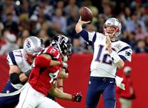 Feb 5, 2017; Houston, TX, USA; New England Patriots quarterback Tom Brady (12) throws a pass during the second quarter against the Atlanta Falcons during Super Bowl LI at NRG Stadium. Mandatory Credit: Matthew Emmons-USA TODAY Sports