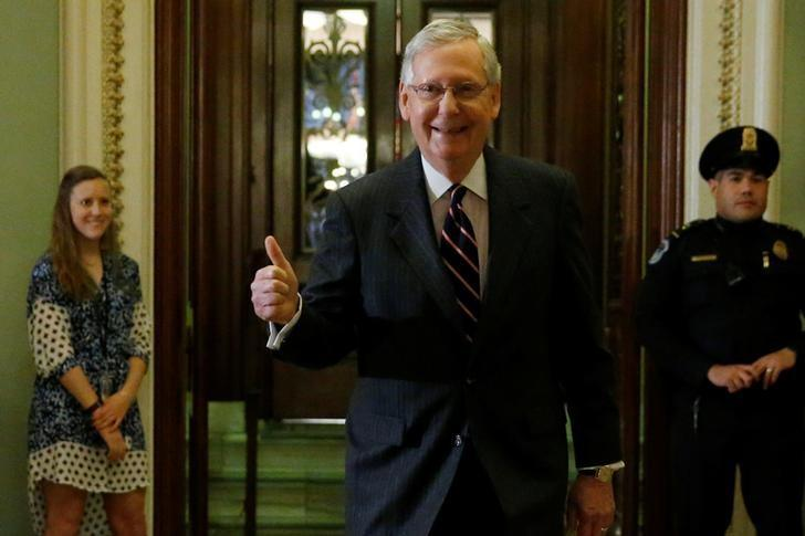U.S. Senate Majority Leader Mitch McConnell (R-KY) gives a thumbs-up after Republicans used a tie-breaking vote in the Senate to confirm Education Secretary Betsy DeVos, at the U.S. Capitol in Washington, U.S. February 7, 2017.  REUTERS/Jonathan Ernst