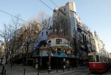 "The Hundertwasser House landmark, an apartment house designed by artist and architect Friedensreich Hundertwasser, with the ""Terrassencafe im Hundertwasserhaus"" is seen in Vienna, Austria, February 15, 2017. REUTERS/Heinz-Peter Bader"
