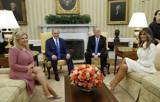 U.S. President Donald Trump (2ndR) and first lady Melania Trump meet Israeli Prime Minister Benjamin Netanyahu and his wife Sara (L) in the Oval Office of White House in Washington, U.S., February 15, 2017. REUTERS/Kevin Lamarque