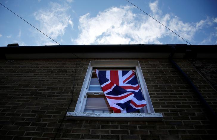 A British flag flutters in front of a window in London, Britain, June 24, 2016 after Britain voted to leave the European Union in the EU BREXIT referendum.       REUTERS/Reinhard Krause/Files