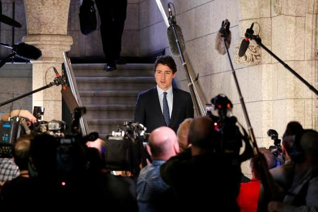 Canada's Prime Minister Justin Trudeau walks to the House of Commons on Parliament Hill in Ottawa, Ontario, Canada, February 14, 2017. REUTERS/Chris Wattie