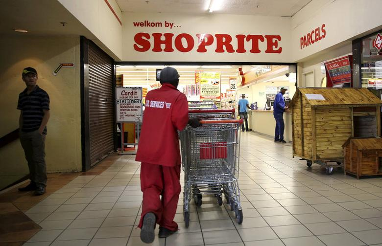 FILE PHOTO: A worker pushes trolleys at the Shoprite store in Johannesburg, South Africa February 23, 2016. REUTERS/Siphiwe Sibeko/File Photo