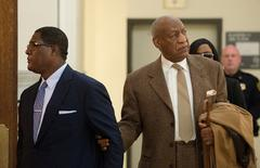 File Photo: Bill Cosby (R) re-enters Montgomery County Courthouse after a break during the second day of his pre-trial hearing in his sexual assault case in Norristown, Pennsylvania, December 14, 2016.  REUTERS/Chloe Elmer/Pool/File Photo