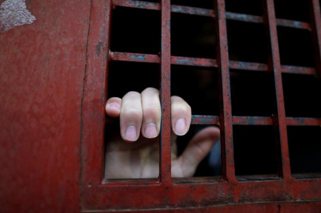 The hand of Ghaffar Abdel Rahman, 33, an Islamic State member, is seen from a cell in Sulaimaniya, Iraq February 15, 2017. REUTERS/Zohra Bensemra