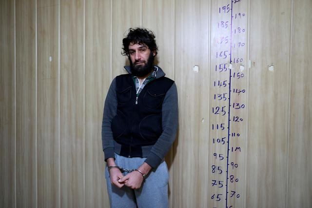 Ghaffar Abdel Rahman, 33, an Islamic State member, stands at an interrogation room in Sulaimaniya , Iraq February 15, 2017. REUTERS/Zohra Bensemra