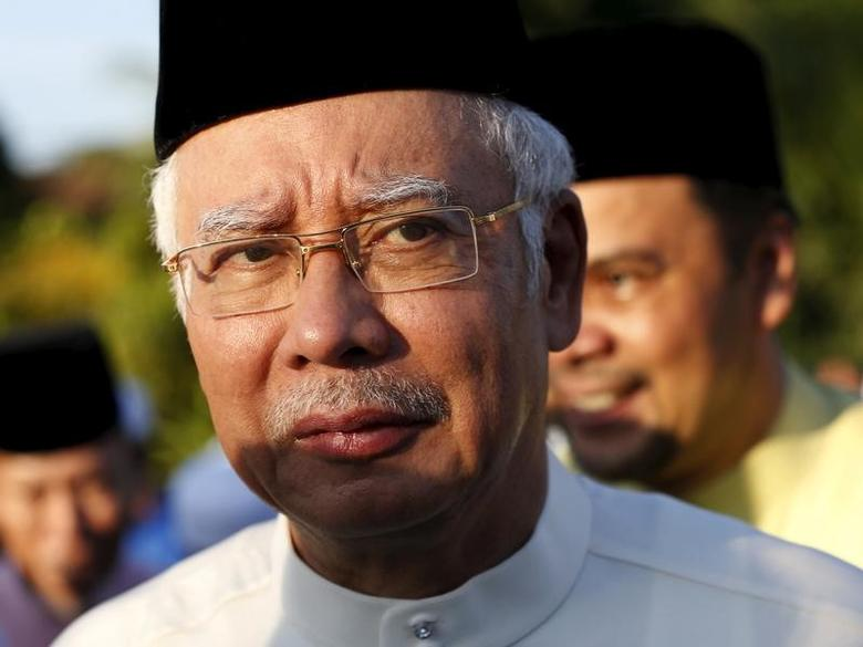 Malaysia's Prime Minister Najib Razak arrives for a news conference at a mosque outside Kuala Lumpur, Malaysia, July 5, 2015.   REUTERS/Olivia Harris/Files
