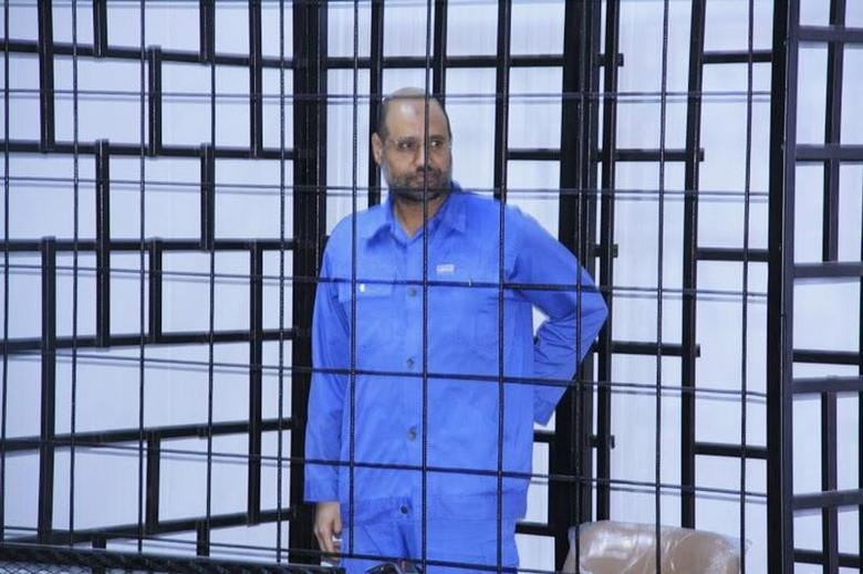 Saif al-Islam Gaddafi, son of late Libyan leader Muammar Gaddafi, attends a hearing behind bars in a courtroom in Zintan, June 22, 2014 . REUTERS/Stringer/Files
