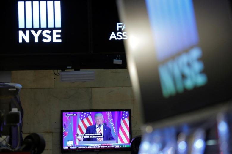 U.S. President-elect Donald Trump is broadcast on a screen on the floor at the New York Stock Exchange (NYSE) in Manhattan, New York City, U.S. December 27, 2016. REUTERS/Andrew Kelly/File Photo
