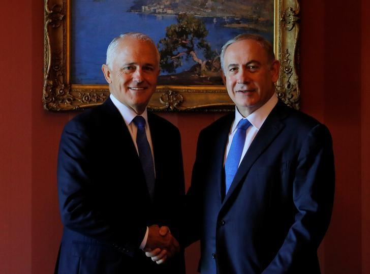 Israeli Prime Minister Benjamin Netanyahu (R) and Australian Prime Minister Malcolm Turnbull shake hands before their bilateral meeting at Admiralty House in Sydney, Australia, February 22, 2017.   REUTERS/Jason Reed