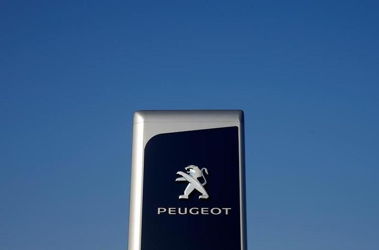 The logo of Peugeot is seen at a dealership of the brand in Strasbourg, France, February 14, 2017. REUTERS/Vincent Kessler