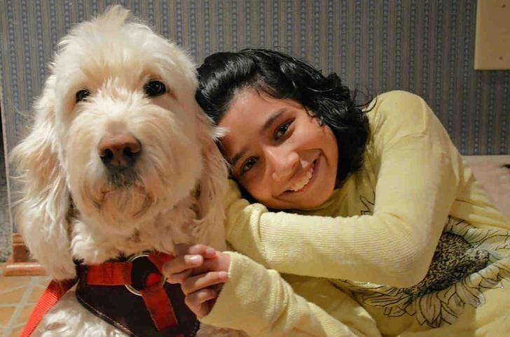 Ehlena Fry and her trained service dog, Wonder, are shown in this handout photo provided by the American Civil Liberties Union.  Family photo, courtesy ACLU/Handout via REUTERS