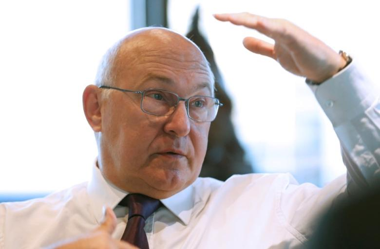 French Finance Minister Michel Sapin speaks during an interview with Reuters in his office at the Bercy Ministry in Paris, France, October 4, 2016. REUTERS/Jacky Naegelen