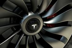 A wheel of a  prototype of the Tesla Model 3 on display in front of the factory during a media tour of the Tesla Gigafactory, which will produce batteries for the electric carmaker in Sparks, Nevada, U.S. July 26, 2016.  REUTERS/James Glover II/File Photo