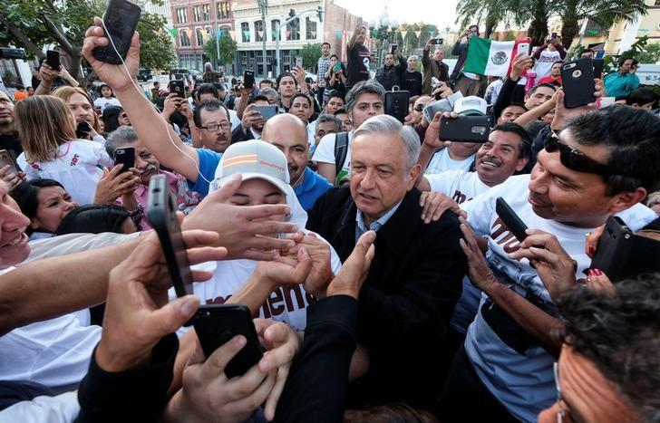 Mexican politician Andres Manuel Lopez Obrador, (C), leader of the National Regeneration Movement (MORENA) party greets supporters as he arrives for a meeting at Plaza Olivera in Los Angeles, California, U.S., February 12, 2017. REUTERS/Ringo Chiu