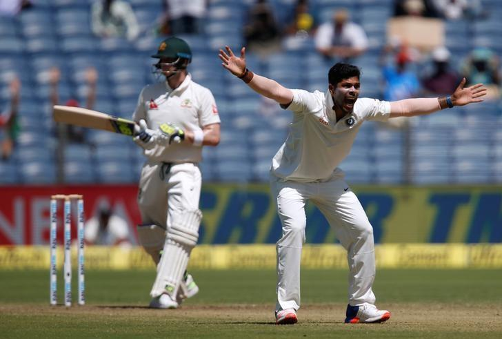 Cricket - India v Australia - First Test cricket match - Maharashtra Cricket Association Stadium, Pune, India - 23/02/17. India's Umesh Yadav unsuccessfully appeals for the wicket of Australia's captain Steven Smith. REUTERS/Danish Siddiqui