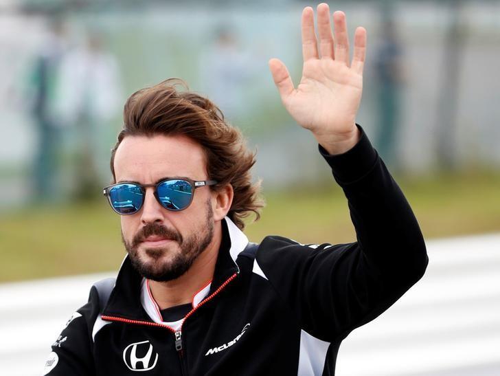 Formula One - Japanese Grand Prix - Suzuka Circuit, Japan- 9/10/16. McLaren's driver  Fernando Alonso of Spain attends the drivers parade. REUTERS/Toru Hanai