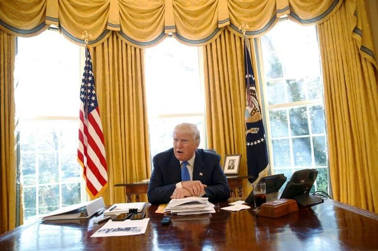 FILE PHOTO: U.S. President Donald Trump gives an interview from his desk in the Oval Office at the White House in Washington, U.S., February 23, 2017. REUTERS/Jonathan Ernst/File Photo