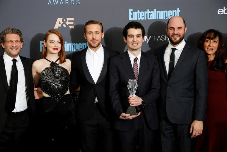 (L-R) Producer Gary Gilbert, actors Emma Stone and Ryan Gosling, director Damien Chazelle, producer Jordan Horowitz and costume designer Mary Zophres pose backstage with their award for Best Picture for 'La La Land'' during the 22nd Annual Critics' Choice Awards in Santa Monica, California, U.S., December 11, 2016.  REUTERS/Danny Moloshok/File Photo