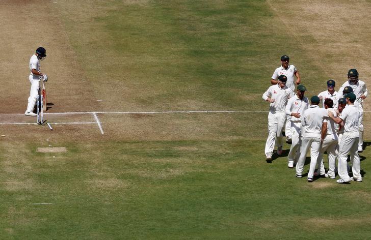 Cricket - India v Australia - First Test cricket match - Maharashtra Cricket Association Stadium, Pune, India - 25/02/17. Australia's players celebrate the wicket of India's captain Virat Kohli. REUTERS/Danish Siddiqui/Files