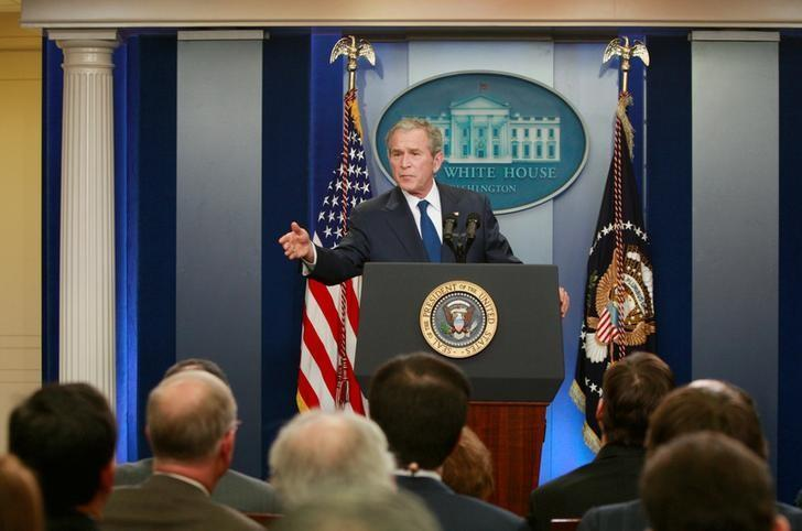 FILE PHOTO - George W. Bush during a news conference in the Brady press briefing room at the White House in Washington, DC, U.S. on January 12, 2009. REUTERS/Jason Reed/File Photo