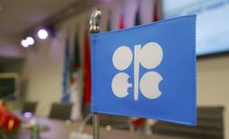 FILE PHOTO -  A flag with the Organization of the Petroleum Exporting Countries (OPEC) logo is seen before a news conference at OPEC's headquarters in Vienna, Austria, December 10, 2016. REUTERS/Heinz-Peter Bader