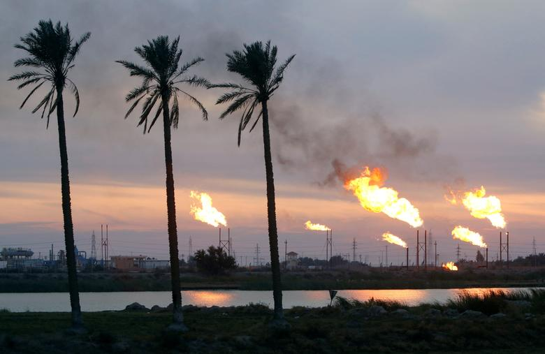Flames emerge from flare stacks at the oil fields in Basra, Iraq January 17, 2017. REUTERS/Essam Al-Sudani/File Photo