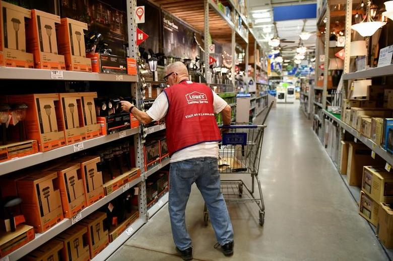 An employee restocks items at a Lowe's home improvement chain in Austin, Texas, U.S., February 27, 2017. REUTERS/Mohammad Khursheed