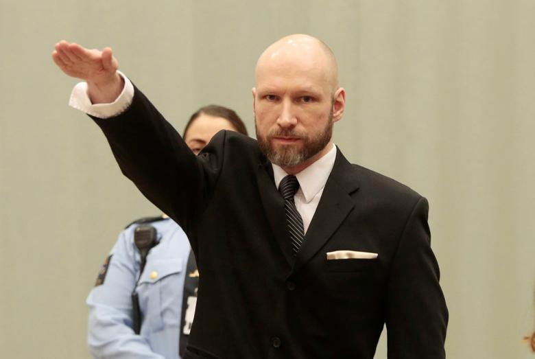 Anders Behring Breivik raises his right hand during the appeal case in Borgarting Court of Appeal at Telemark prison in Skien, Norway, 10 January 2017. NTB Scanpix/Lise Aaserud via REUTERS/Files