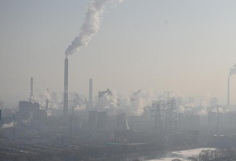 Smog billows from chimneys and cooling towers of a steel plant during hazy    weather in Taiyuan, Shanxi province, China, December 28, 2016. REUTERS/Stringer