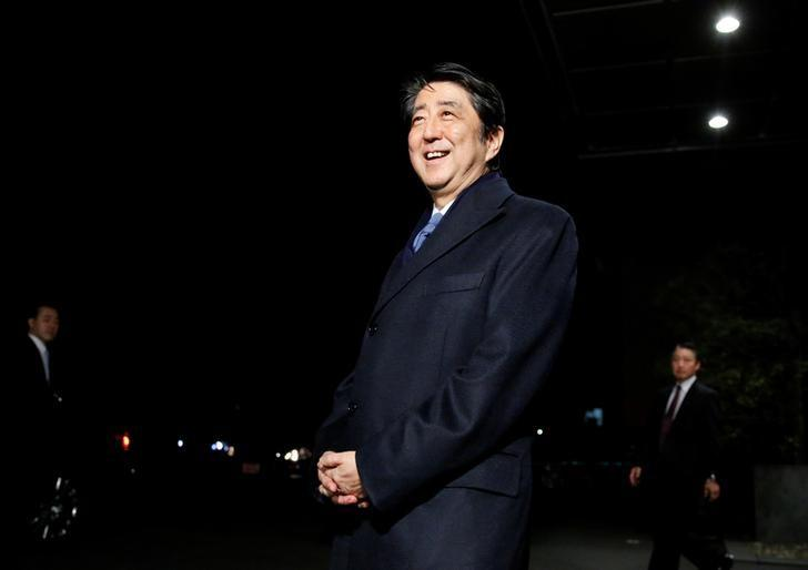 Japan's Prime Minister Shinzo Abe speaks to the media after attending a concert for Premium Friday, which encourages firms to let workers out a few hours early on the last Friday of every month so that they spend money on shopping and leisure to help boost the economy, in Tokyo, Japan February 24, 2017. REUTERS/Toru Hanai/Files