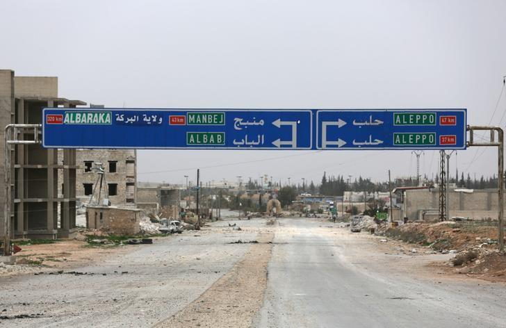 A road sign that shows the direction to Manbij city is seen in the northern Syrian town of al-Bab, Syria March 1, 2017. Picture taken March 1, 2017. REUTERS/Khalil Ashawi