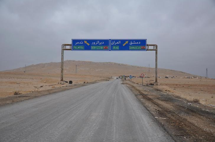 A road sign that shows the direction to the Syrian city of Palmyra is pictured on the edge of the city, in this handout picture provided by SANA on March 2, 2017, Syria. SANA/Handout via REUTERS