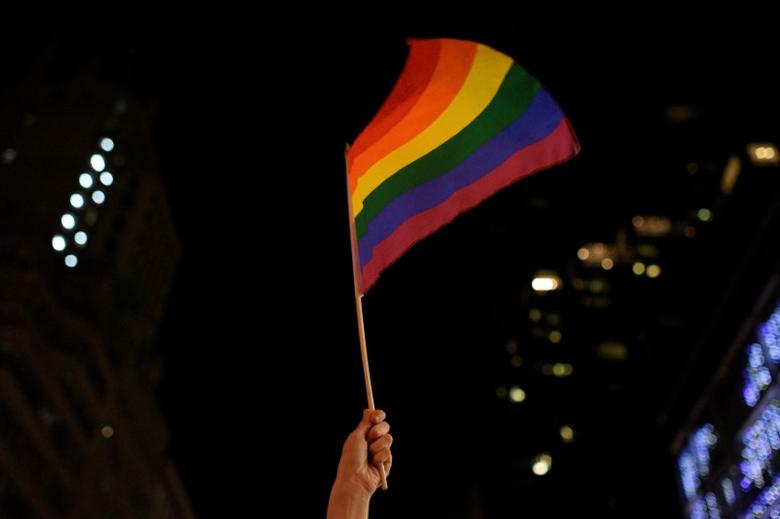 An activist waves a rainbow flag during the ''Queer and Trans Dance Party'' in protest of U.S. President Donald Trump outside of Trump Tower in Manhattan, New York, U.S., February 26, 2017. REUTERS/Darren Ornitz