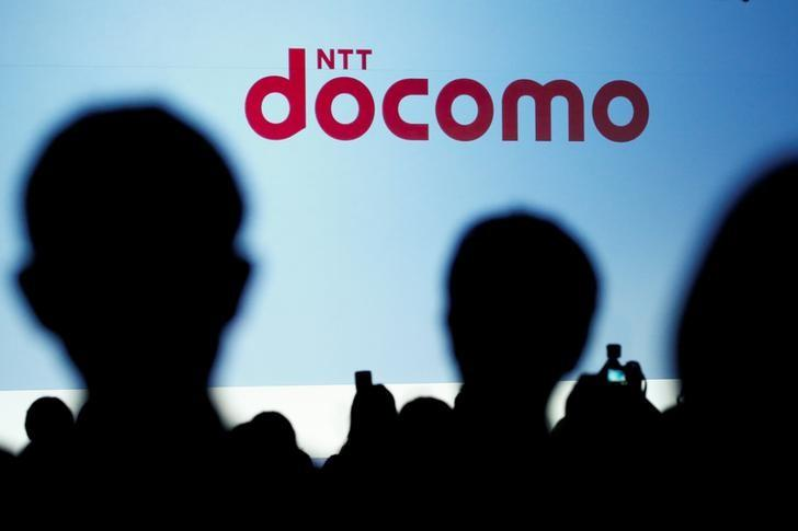 People attend a product unveiling event of the Japanese mobile communications company NTT Docomo in Tokyo, Japan, May 11, 2016. REUTERS/Thomas Peter/Files