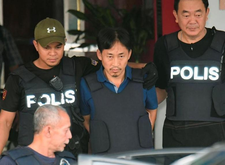 North Korean suspect in Kim Jong Nam murder, Ri Jong Chol, leaves a Sepang police station to be deported, in Malaysia March 3, 2017, in this photo taken by Kyodo.  Mandatory credit Kyodo/via REUTERS