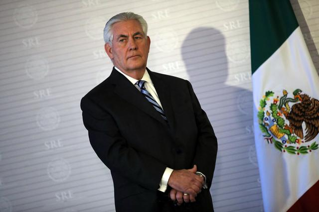 U.S. Secretary of State Rex Tillerson stands next to a Mexican flag during a join statement with Mexico's Foreign Secretary Luis Videgaray at the Ministry of Foreign Affairs in Mexico City, Mexico February 23, 2017.  REUTERS/Carlos Barria