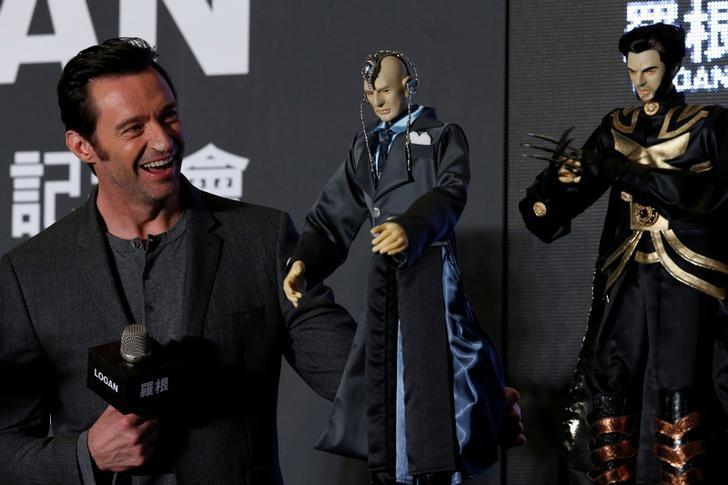 Actor Hugh Jackman poses cloth puppets, a traditional type of opera during a news conference during Asian premiere of the X-Men series film 'Logan' in Taipei, Taiwan February 28, 2017.  REUTERS/Tyrone Siu