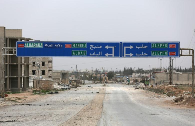 A road sign that shows the direction to Manbij city is seen in the northern Syrian town of al-Bab, Syria March 1, 2017.  REUTERS/Khalil Ashawi