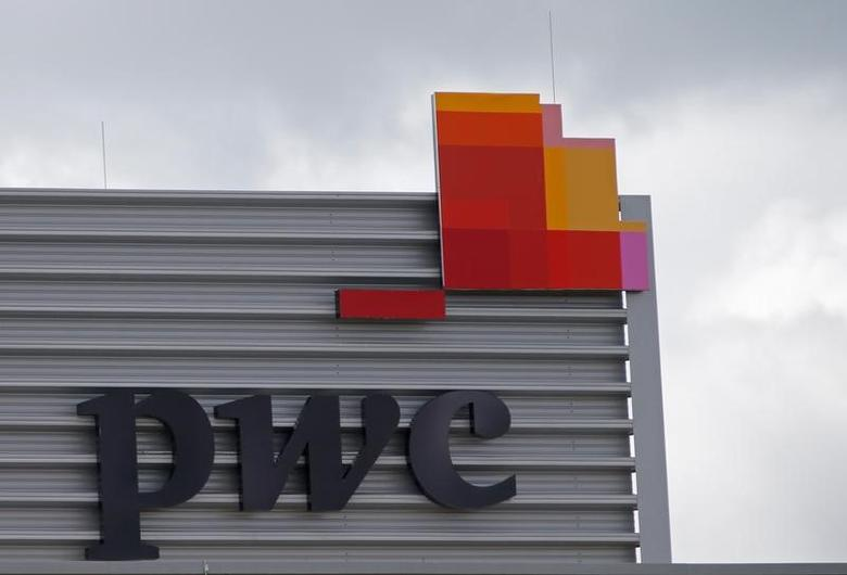 FILE PHOTO: The logo of PricewaterhouseCoopers is seen on the local offices building of the company in Luxembourg, April 26, 2016. REUTERS/Vincent Kessler