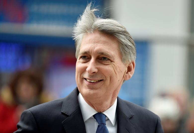 FILE PHOTO:Britain's Chancellor of the Exchequer Philip Hammond  arrives at the National Cyber Security Centre in London, Britain, February 14, 2017. REUTERS/Hannah McKay/File Photo