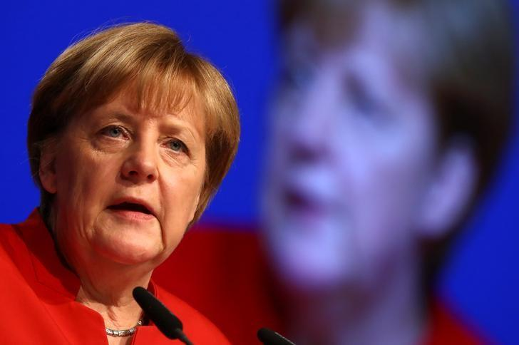 FILE PHOTO: German Chancellor and leader of the conservative Christian Democratic Union party CDU Angela Merkel addresses the CDU party convention in Essen, Germany, December 6, 2016.      REUTERS/Kai Pfaffenbach/Files