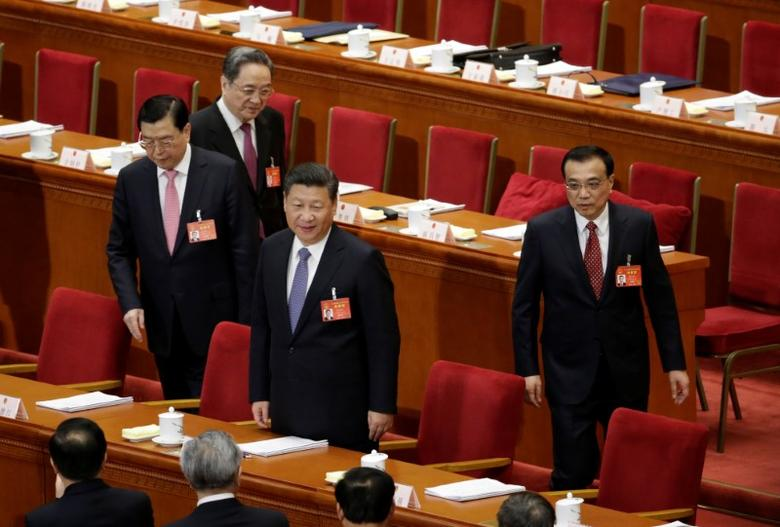 China's President Xi Jinping (2nd R), Premier Li Keqiang (R), Chairman of the Standing Committee of the National People's Congress (NPC) Zhang Dejiang (L) and Chairman of the Chinese People's Political Consultative Conference (CPPCC) Yu Zhengsheng attend the second plenary session of the NPC at the Great Hall of the People in Beijing, China, March 8, 2017. REUTERS/Jason Lee