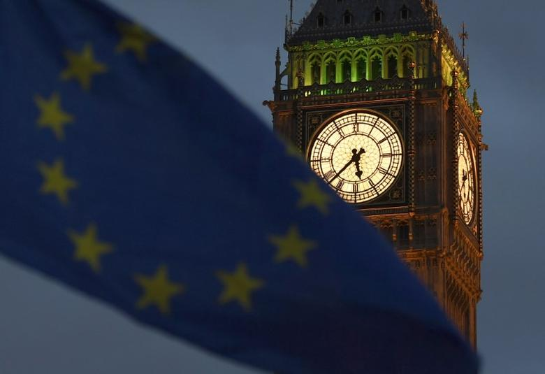 A European Union flag is waved in front of Big Ben and the Houses of Parliament in London, Britain, February 20, 2017. REUTERS/Toby Melville