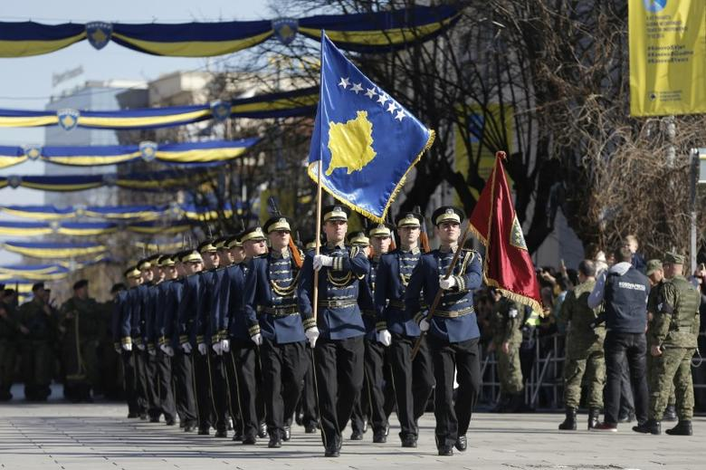 Members of Kosovo Security Forces (KSF) march during a celebration marking the eighth anniversary of Kosovo's declaration of independence from Serbia, in Pristina February 17, 2016. REUTERS/Marko Djurica
