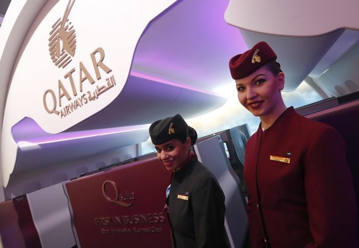 Qatar Airways stewardesses pose at the International Tourism Trade Fair ITB in Berlin, Germany, March 8, 2017.      REUTERS/Fabrizio Bensch/Files